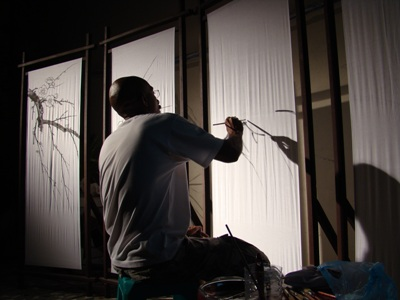 dad working on his wonderful concept of japanese screens for the backdrop in the wedding reception