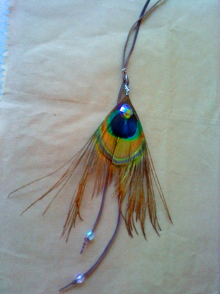 the necklace i made with a peacock feather and some beads